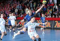 Dijana Golubic and Katarina Mravikova (7) at EHF Champions league handball match in Group II between RK Krim Mercator and Gyori Audi Eto KC, on February 7, 2009, in Kodeljevo, Ljubljana, Slovenia. Gyori won 35:31. (Photo by Vid Ponikvar / Sportida)
