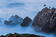 Long exposure of waves and coastal rocks at Moss Beach, San Mateo County coast, California