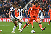 West Bromwich Albion midfielder Harvey Barnes (15), on loan from Leicester City shoots at goal blocked by Millwall defender Jake Cooper (5) during the EFL Sky Bet Championship match between West Bromwich Albion and Millwall at The Hawthorns, West Bromwich, England on 22 September 2018.