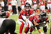 Atlanta Falcons QB Matt Ryan calls out the play at the line of scrimmage during the game against the New Orleans Saints. New Orlenas Sainst (k) kicker Garrett Hartley (5) kicks a field  goal to tie the game and seend it to OT against the Atlanta Falcons, then misses a field goal in OT and teh Falcons went on to win 27-24.The Super Bowl Champions New Orleans Saints play the Atlanta Falcons Sunday Sept 26, 2010 in New Orleans at the Super Dome in Louisiana.  The Saints and Falcons are tied at half time and went into overtime tied 24-24. Hartley missed a kick to win in overtime., the Atlanta Falcons went on to win on OT with a field goal 27-24. PHOTO©SuziAltman.com