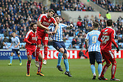 Swindon Town defender Jamie Sendles-White (21)   gets the better of Coventry City forward Darius Henderson (44)  during the Sky Bet League 1 match between Coventry City and Swindon Town at the Ricoh Arena, Coventry, England on 19 March 2016. Photo by Simon Davies.