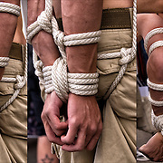 S&amp;M Bondage, close up of slave being tied up with ropes at Folsom Street East, S&amp;M-leather-fetish themed street festival.<br /> <br /> <br />      Bondage - GOR-87820-12<br /> Rope Bondage - GOR-87819-12<br /> Rope Bondage - GOR-87831-12