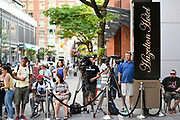 People gather outside the Hazelton Hotel, Wednesday, July 3, 2019, in Toronto.  A large crowd was forming outside the posh downtown hotel where Toronto Raptors President Masai Ujiri had been spotted earlier in the day, with the assumption being that the hotel is where a meeting between Kawhi Leonard and the team may be taking place.  (Dylan Stewart/Image of Sport)