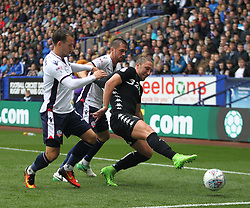 Luke Ayling of Leeds United (R) and Andrew Taylor of Bolton Wanderers (C) in action - Mandatory by-line: Jack Phillips/JMP - 06/08/2017 - FOOTBALL - Macron Stadium - Bolton, England - Bolton Wanderers v Leeds United - English Football League Championship