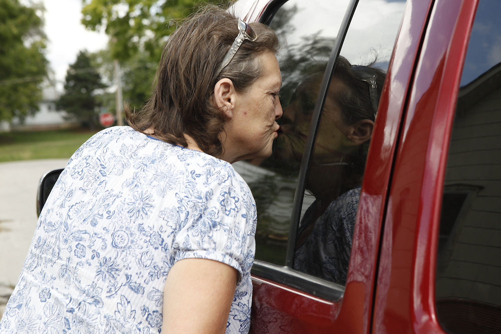 Debbie kisses the car window to try to calm Beau while she drops her grandsons Alex, 6, and Austin, 9, off at a friend's house.