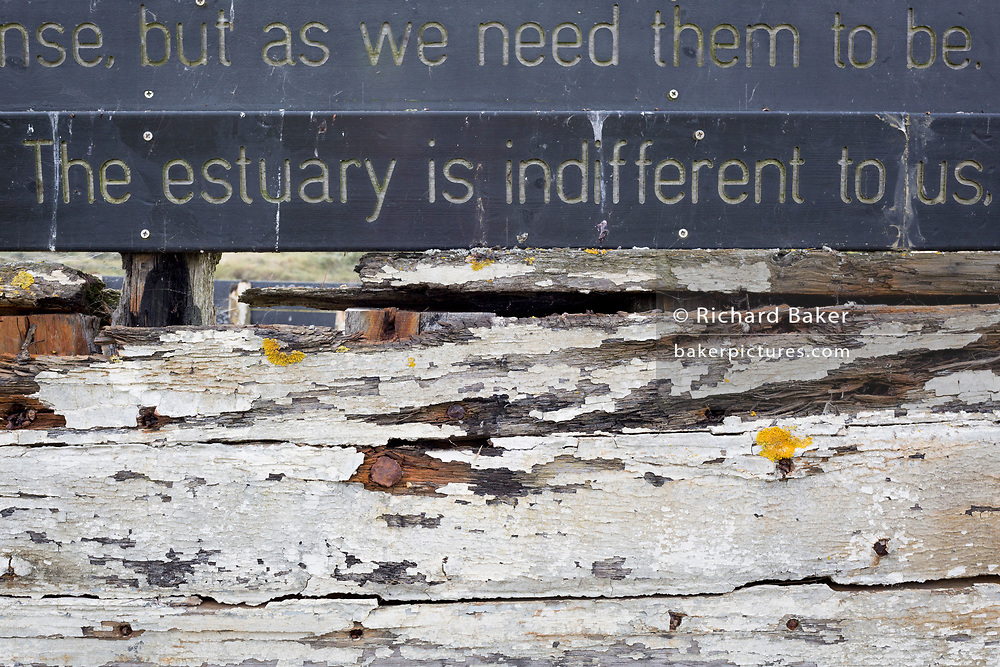 A detail of poetry and sentences forming 'Graveyard of Lost Species', a boat artwork created by by artists and commissioned by Arts Catalyst, at low-tide on the Thames estuary, at Leigh creek, on 10th September 2019, in Leigh-on-Sea, Essex, England. The project celebrates the local tradition of wrecking boats on the salt marsh, its decaying memory of what has changed or passed. The boat is the 'Souvenir', a 39-foot Thames 'bawley' (1933) which once served the local fish trade in nearby Southend-on-Sea.