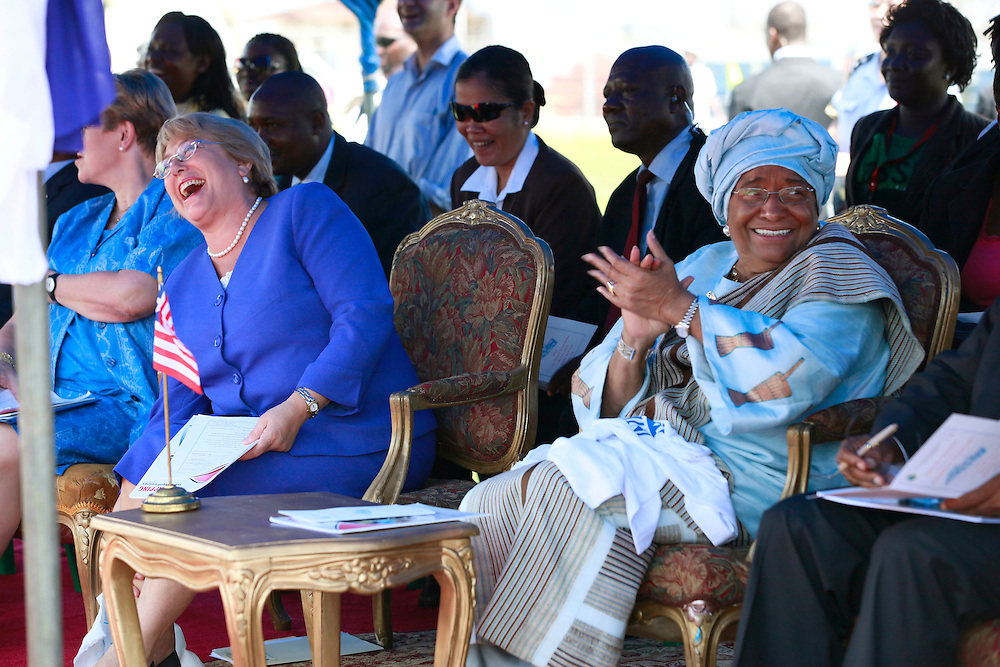 Michelle Bachelet, executive director of U.N. Women and former President of Chile, left, shares a moment with President Ellen Johnson Sirleaf of Liberia, right, at the International Women's Day celebration in Monrovia, Liberia, Tuesday, March 8, 2011. Bachelet is visiting Liberia to commemorate the 100th anniversary of International Women's Day. (Stuart Ramson for the United Nations Foundation)