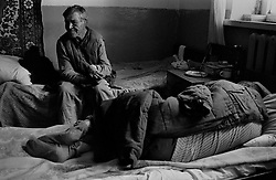 Residents of  house for an old released prisoners sleep on their beds in barrack where they live in village Blagoveshenka, Kemerovo region, Eastern Siberia, Russia, 07 December 1999. Blagoveshensky house for an old former prisoners a special institution which is a part of a penitentiary system where live former prisoners which have age more then 55 years after released and haven't house or an apartment and relatives.
