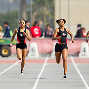 23 March 2018: Tyra Lea and Lakin Hatcher compete in the 400m dash open event Friday morning at the 40th Annual Aztec Invitational.<br /> More game action at sdsuaztecphotos.com