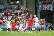 England Defender Eric Dier and England Forward Jamie Vardy jump to head the ball during the Euro 2016 Group B match between Slovakia and England at Stade Geoffroy Guichard, Saint-Etienne, France on 20 June 2016. Photo by Phil Duncan.