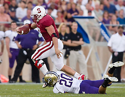 September 26, 2009; Stanford, CA, USA; Stanford Cardinal running back Toby Gerhart (7) breaks a tackle by Washington Huskies cornerback Justin Glenn (20) on a touchdown run in the first quarter at Stanford Stadium.