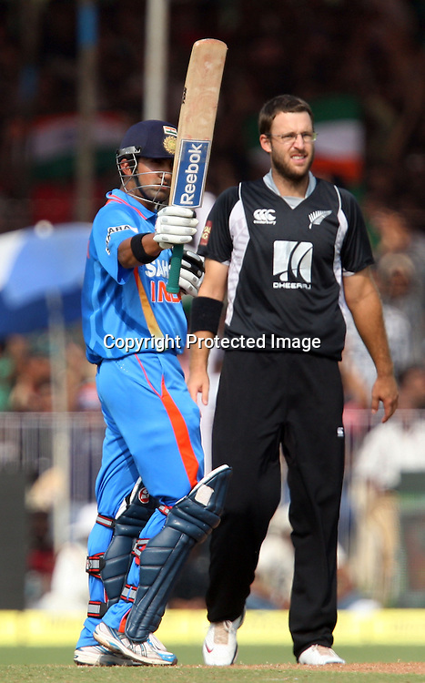 Indian captain Gautam Gambhir celebrates half century against New Zealand during the 3rd ODI India vs New Zealand Played at Reliance Stadium, Vadodara<br /> 4 December 2010 (50-over match)