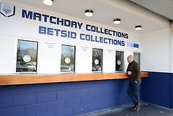 A fan collects a ticket from the Ticket Collection point at the Deepdale Stadium - Photo mandatory by-line: Dougie Allward/JMP - Mobile: 07966 386802 - 11/04/2015 - SPORT - Football - Preston - Deepdale - Preston North End v Bristol City - Sky Bet League One
