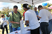 Volunteer riders signing in before the Tugo Bike Share Ride-Out