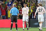 Manchester United Defender Chris Smalling argues with Referee Mike Dean during the Premier League match between Watford and Manchester United at Vicarage Road, Watford, England on 15 September 2018.