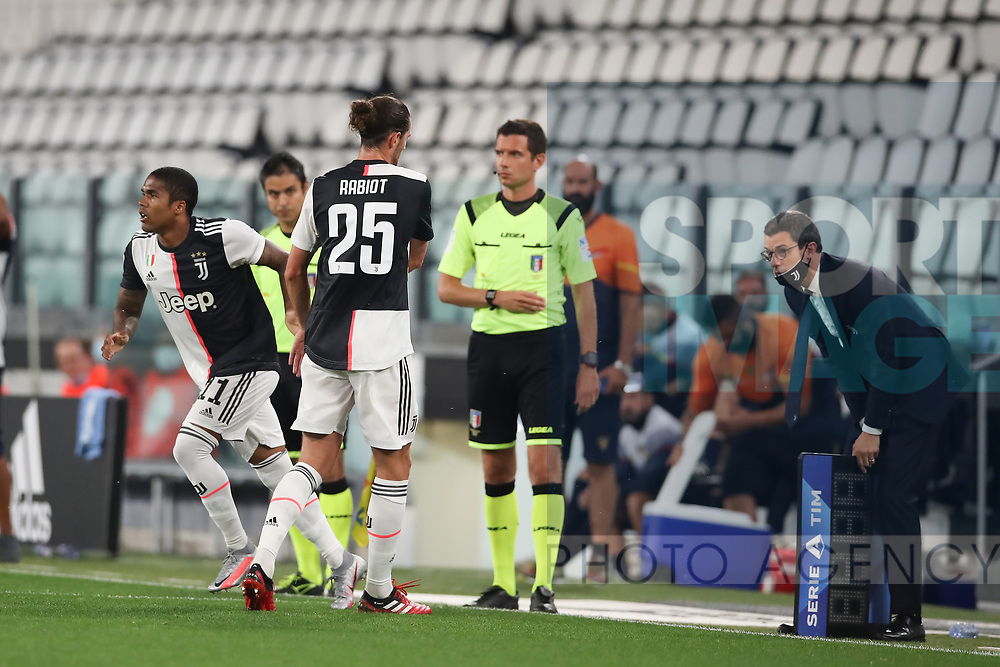 Juventus's French midfielder Adrien Rabiot is substituted for Brazilian striker Douglas Costa during the Serie A match at Allianz Stadium, Turin. Picture date: 26th June 2020. Picture credit should read: Jonathan Moscrop/Sportimage