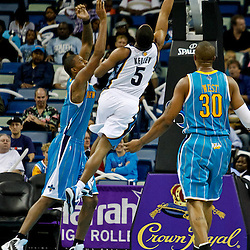 October 9, 2010; New Orleans, LA, USA; Memphis Grizzlies guard Tre Kelly shoots over New Orleans Hornets small forward Trevor Ariza (1) and power forward David West (30) during the second quarter of a preseason game at the New Orleans Arena. Mandatory Credit: Derick E. Hingle