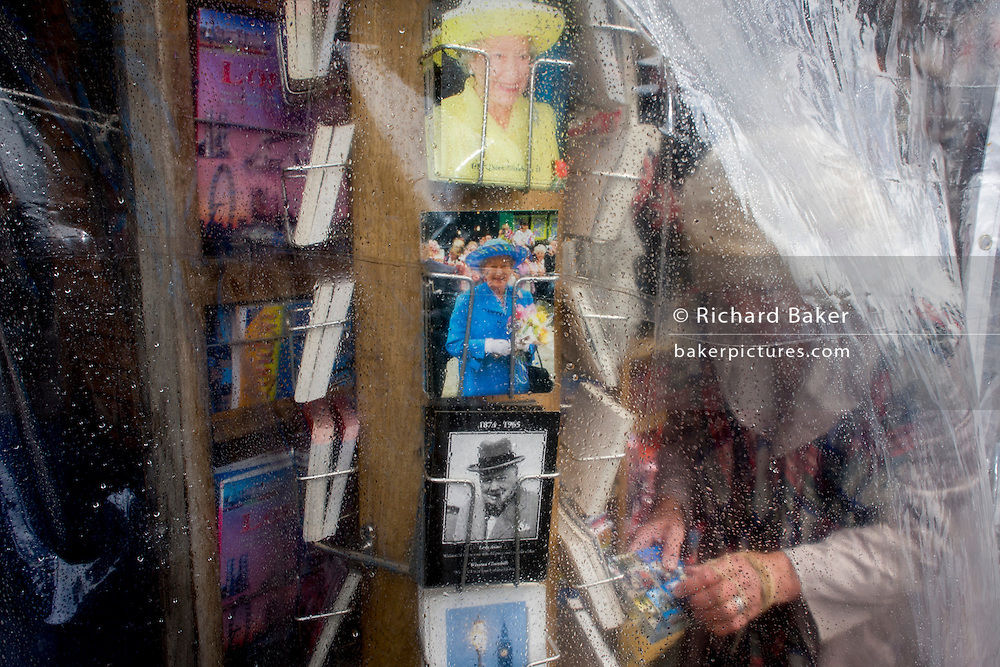 Queen Elizabeth and Winston Churchill appear on a rack of postcards in Westminster, central London.