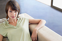Woman relaxing on sofa elevated view portrait