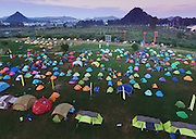 QIANXINAN, CHINA - OCTOBER 12: (CHINA OUT) <br /> <br /> Thousands Of Tents Appear During The International Camping Congress<br /> <br /> Aerial view of tents on the square beside the Sancha River during the International Camping Congress in Zhenfeng County as a part of The First International Mountain Tourism Conference on October 12, 2015 in Qianxinan Buyei and Miao Autonomous Prefecture, Guizhou Province of China. Campers from all over the world gathered and sent thousands of tents on the square beside the Sancha River in Qianxinan during the International Camping Congress as a part of The First International Mountain Tourism Conference. <br /> ©Exclusivepix Media