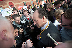 Liberal Democrat party conference delegate Patrick Streeter surrounded by press and demonstrators after attempting to gate crash the Demo's start and address the demonstrators at Devonshire Green Sheffield Sheffield city Hall where the Liberal Democrats are holding their Party conference Sheffield Saturday 12 March 2011.Images © Paul David Drabble