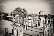 U Bein Bridge, Amarapura city, Mandalay, Myanmar. The bridge is more than a almost 2 km long and built solely from Burmese teak.