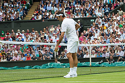 LONDON, ENGLAND - Monday, July 4, 2016:  Roger Federer (SUI) checking the court during the Gentlemen's Single 4th Round match on day eight of the Wimbledon Lawn Tennis Championships at the All England Lawn Tennis and Croquet Club. (Pic by Kirsten Holst/Propaganda)