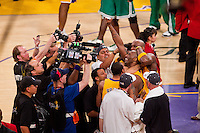 17 June 2010:  Guard Kobe Bryant of Los Angeles Lakers with the ball celebrates with Shannon Brown and Lamar Odom after the Lakers defeat the Boston Celtics 83-79 and win the NBA championship in Game 7 of the NBA Finals at the STAPLES Center in Los Angeles, CA.