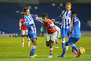 Arsenal's Gedion Zelalem is fouled during the Barclays U21 Premier League match between Brighton U21 and Arsenal U21 at the American Express Community Stadium, Brighton and Hove, England on 1 December 2014.
