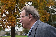 Witney, Oxfordshire, UK. 20th October 2016. Green candidate Larry Sanders, the 83-year-old brother of one-time US presidential hopeful Bernie Sanders canvasses and visits polling stations on the day of the Witney by-election following David Cameron's resignation. Pictured: Larry Sanders walks past trees in full Autumnal colours.  // Lee Thomas, Flat 47a Park East Building, Bow Quarter, London, E3 2UT. Tel. 07784142973. Email: leepthomas@gmail.com   www.leept.co.uk (0000635435)