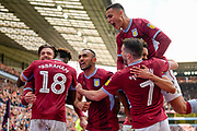 Aston Villa striker(on loan from Chelsea) Tammy Abraham (18) scores a penalty and celebrates  with team mates Aston Villa midfielder Jack Grealish (10), Aston Villa defender Ahmed Elmohamady (27), Aston Villa midfielder John McGinn (7) and Aston Villa striker (on loan from Lille) Anwar El Ghazi (22) during the EFL Sky Bet Championship first leg Play Off match between Aston Villa and West Bromwich Albion at Villa Park, Birmingham, England on 11 May 2019.