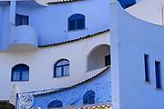 Cityscape with colourful buildings at Giardini Naxos near Taormina, Sicily, Italy