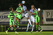 Cheltenham Town's Easah Suliman and Forest Green Rovers Matt Tubbs (20) challenge for a header during the Gloucestershire Senior Cup match between Forest Green Rovers and Cheltenham Town at the New Lawn, Forest Green, United Kingdom on 20 September 2016. Photo by Shane Healey.