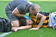 Ryan Inniss gets medical attention after a clash during the Sky Bet League 1 match between Bury and Port Vale at Gigg Lane, Bury, England on 19 September 2015. Photo by Mark Pollitt.