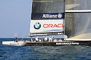 United States team BMW Oracle Racing relaxes at end of a long afternoon of America's Cup fleet racing; Valencia, Spain.