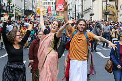 © Licensed to London News Pictures. 16/06/2019. London, UK. Hare Krishna pilgrims and devotees celebrate the 51st anniversary event of Rathayatra, and the annual Krishna Chariot festival is celebrated all over the world. Rathayatra - the wooden chariots carrying deities of Jagannatha, Balarama and Subhadra which are pulled by hand by pilgrims and devotees. The giant chariots are accompanied by a procession of singers, musicians, and dancers. Photo credit: Dinendra Haria/LNP