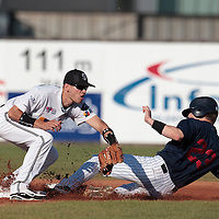 06 June 2010:  Second base Martin Schneider of AVG Draci Brno eyes the ball as Aaron Hornostaj of Rouen slides safely into second base during the 2010 Baseball European Cup match won 10-8 by the Rouen Huskies over AVG Draci Brno, at the AVG Arena, in Brno, Czech Republic.
