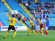 Kyle Dempsey of Carlisle United (top) scores from a header his team's first goal during the Sky Bet League 2 match at Brunton Park, Carlisle<br /> Picture by Greg Kwasnik/Focus Images Ltd +44 7902 021456<br /> 06/09/2014