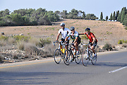 Israel, Carmel mountains, a group of bicycle riders helping a weaker rider