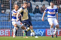 Leeds United's Ross McCormack  and QPR's Karl Henry compete for the ball - Photo mandatory by-line: Mitchell Gunn/JMP - Tel: Mobile: 07966 386802 01/03/2014 - SPORT - FOOTBALL - Loftus Road - London - Queens Park Rangers v Leeds United - Championship