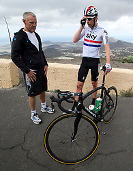 © London News Pictures. File picture dated. 19/05/2012. Tenerife, Spain. Three time Olympic gold medalist cyclist BRADLEY WIGGINS (right) with his head coach SHANE SUTTON (left) during  training on island of Tenerife in Spain. British Cycling technical director Shane Sutton has been suspended amid an investigation into discrimination allegations.. Photo credit: Ben Cawthra/LNP