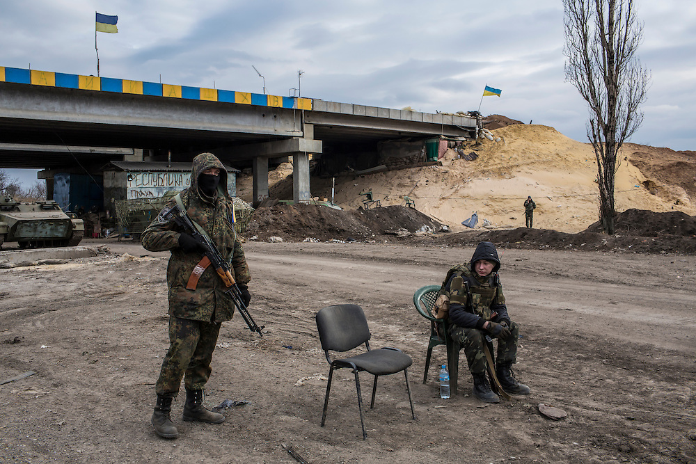 PERVOMAISKE, UKRAINE - MARCH 19, 2015: Members of the pro-Ukrainian Dnipro-1 battalion guard a checkpoint at one of the group's bases known as The Bridge near ongoing battles for the town of Pisky in Pervomaiske, Ukraine. CREDIT: Brendan Hoffman for The New York Times