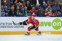 PENTICTON, CANADA - SEPTEMBER 17: Roman Dyukov #76 of Calgary Flames passes the puck against the Edmonton Oilers on September 17, 2016 at the South Okanagan Event Centre in Penticton, British Columbia, Canada.  (Photo by Marissa Baecker/Shoot the Breeze)  *** Local Caption *** Roman Dyukov;
