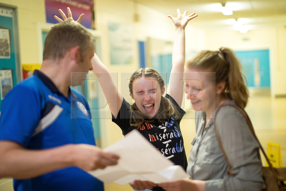 © Licensed to London News Pictures . 24/08/2017 . Rochdale , UK . EMILY CAVANAH (15, from Norden - turns 16 on Saturday 26th August gets 2xA**, 5xA*, 4xA) cries with joy with father and mother COLIN and JO . Students at Oulder Hill Community School collect their GCSE exam results . Photo credit : Joel Goodman/LNP