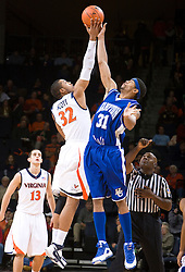 Virginia forward Mike Scott (32) goes up with Hampton forward Donte Harrison (31) for the opening tip off.  The Virginia Cavaliers defeated the Hampton Pirates 74-48 at the John Paul Jones Arena on the Grounds of the University of Virginia in Charlottesville, VA on December 23, 2008. (Special to the Daily Progress / Jason O. Watson)