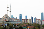 Traditional mosque contrasts with skyscrapers of Levent, financial business district of Istanbul, Republic of Turkey