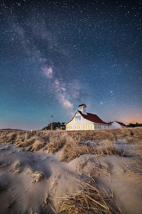 I've wanted to get an image of this iconic building at Popham Beach for a long, long time. This morning, I almost missed my chance. I got hung up capturing the northern lights and then chatting with a friend, which nearly derailed my plan to venture over here. It's serendipitious, though, because the pre-dawn, nautical twilight that I thought would ruin my photo actually helped me immensely in capturing this image. The very faint glow on the horizon at 4:30 AM signaled the first stage of sunrise. As it brightened, the stars began to fade, but it also cast this mysterious glow on the landscape at the same time. The glow shone on the Life Saving Station and lit up the beautiful dunes and grasses in the foreground, making this capture much more powerful than anything I could have captured in the dark of full night.I can't get over how sharp this came out. This is a 30 second exposure at f/2.8! ISO 3200! It's simply amazing how good these modern cameras can be at gathering light. I can't wait to see prints of this one.