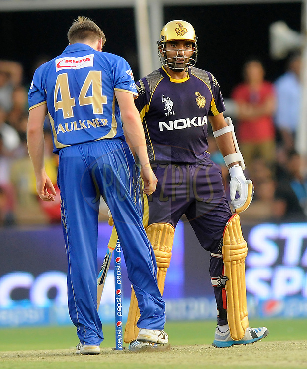 James Faulkner of the Rajatshan Royals and Robin Uthappa of the Kolkata Knight Riders exchange few words during match 25 of the Pepsi Indian Premier League Season 2014 between the Rajasthan Royals and the Kolkata Knight Riders held at the Sardar Patel Stadium, Ahmedabad, India on the 5th May  2014<br /> <br /> Photo by Pal Pillai / IPL / SPORTZPICS      <br /> <br /> <br /> <br /> Image use subject to terms and conditions which can be found here:  http://sportzpics.photoshelter.com/gallery/Pepsi-IPL-Image-terms-and-conditions/G00004VW1IVJ.gB0/C0000TScjhBM6ikg