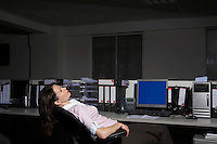 Woman reclining on chair in office