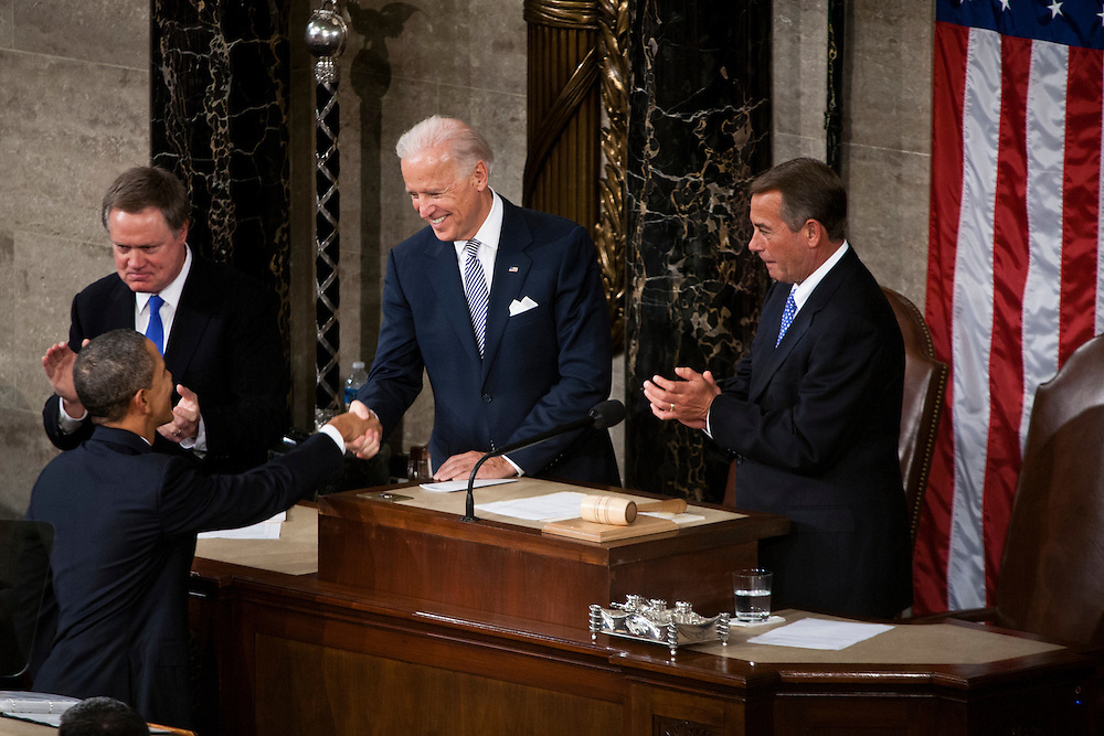 President Barack Obama shakes hands with Vice President Joe Biden as House Speaker John Boehner (R-OH) watches at the State of the Union address in the U.S. Capitol on Tuesday, January 24, 2012 in Washington, DC.
